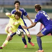 Easy does it: Mizuho Sakaguchi scores Japan's opening goal in a 3-0 win over Taiwan at the Asian Games on Monday. | KYODO