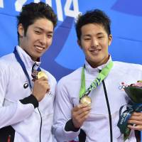 Shared glory: Gold medalist Kosuke Hagino (left) and bronze winner Daiya Seto pose with their medals after the 400-meter individual medley on Wednesday. | AFP-JIJI