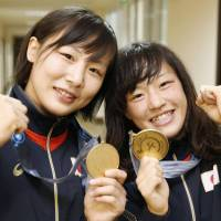 World champions: Chiho Hamada, the 55-kg title winner (left), and Eri  Tosaka, the winner in the 48-kg class, pose with their gold medals in  Tashkent on Thursday. | KYODO