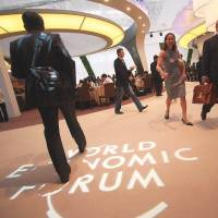 Participants move through the Meijiang Convention and Exhibition Center at the 2012 Annual Meeting of the New Champions in Tianjin, China. | WORLD ECONOMIC FORUM