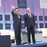 Li Keqiang (left), Premier of the People's Republic of China stands with Klaus Schwab, Founder and Executive Chairman, World Economic Forum at the Opening Plenary of the Annual Meeting of the New Champions 2013 in Dalian, China. | WORLD ECONOMIC FORUM