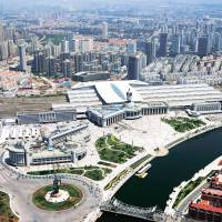 Aerial view of the Tianjin Railway Station surrounded by modern office and residential buildings in Tianjin, China, which will host the Sept. 10 to 12 World Economic Forum's Annual Meeting of the New Champions 2014. | WORLD ECONOMIC FORUM