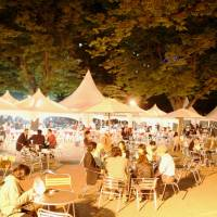 Eat, drink and be merry: Visitors to last year's Sapporo Autumn Fest enjoy local dishes and a variety of drinks.