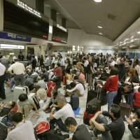Crowds in Tokyo Station await for the resumption of shinkansen service Monday as Typhoon Phanphone. | KYODO