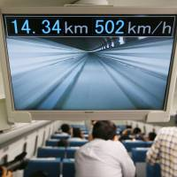 A monitor shows a live view from a magnetic-levitation train developed by Central Japan Railway Co. (JR Tokai) during a trial run in Yamanashi Prefecture in September. | KYODO