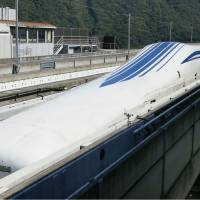 JR Tokai's L0 series maglev train sits on a test track in Tsuru, Yamanashi Prefecture, in September. | KYODO