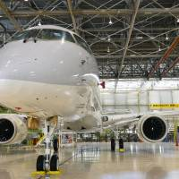 A photo taken in June shows the test model of Mitsubishi Aircraft Corp.'s Mitsubishi Regional Jet, which was unveiled Saturday in a ceremony at a plant in the town of Toyoyama, Aichi Prefecture. | MITSUBISHI AIRCRAFT CORP./KYODO