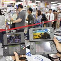 Nintendo's new 3DS console hits shelves in Japan