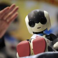 Tomy Co.'s new Robi jr. prototype is unveiled during Japan Robot Week 2014 on Wednesday at Tokyo Big Sight. It has speech recognition and a vocabulary of 1,000 Japanese phrases. | AP