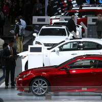 Members of the press preview Lexus vehicles at the North American International Auto Show in Detroit on Jan. 13. For the eighth year in a row, Toyota extended its winning streak atop Consumer Reports' annual reliability survey, released Monday. | AP