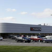 Takata, an automotive parts supplier in Auburn Hills, Michigan, is seen Wednesday. The company is the North American subsidiary of the Japan-based Takata Corp., which supplies seat belts and airbags for the automotive industry. The government's auto safety agency says that inflator mechanisms made by Takata in the airbags can rupture, causing metal fragments to fly out when the bags are deployed. | AP