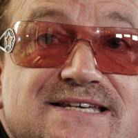 Singer Bono of the band U2 speaks at the opening session of the Oslo Forum in June 2012. The Irish rocker has revealed the mystery behind his trademark sunglasses: He has glaucoma.   REUTERS