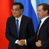 China, Russia seek 'international justice,' agree on currency swap line