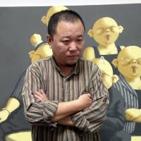 Free-speech illusion at Beijing artists' colony shattered by detentions
