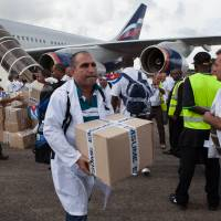 Cuban doctors, nurses head to West Africa to help in Ebola fight