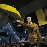 Hong Kong protests subside after tumultuous week