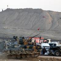 Street fighting rages in key Kurdish town on Syria-Turkey border as Islamic State moves in