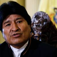 Bolivia's Morales wins reelection with 61 percent: official