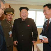 North Korean leader Kim Jong Un (center) is seen during an inspection tour of a newly built housing complex in Pyongyang in this picture taken from Tuesday's edition of the Rodong Sinmun daily. | AFP-JIJI