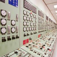 A panel shows the status of a reactor in the control room at Taiwan Power Co.'s No. 2 nuclear power plant in Wanli, Taiwan, in August 2010. | BLOOMBERG