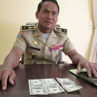 Record bust in Cambodia signals Thai dollar counterfeiting boom