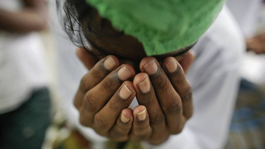 A victim of human trafficking prays at a Thai government shelter in Phang Nga province on Oct. 17.  | REUTERS