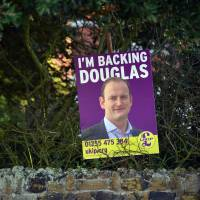 A placard for United Kingdom Independence Party candidate Douglas Carswell is seen in a garden in Frinton-on-Sea, southeast England, on Friday. The coastal resort of Clacton-on-Sea could trigger a sea change in British politics on Thursday by voting UKIP into parliament for the first time. Carswell, the quiet seaside town's sitting member of parliament since 2005, recently defected from Prime Minister David Cameron's Conservative Party to the populist United Kingdom Independence Party. | AFP-JIJI