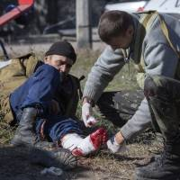 War fears hang over Ukraine as 12 die despite truce