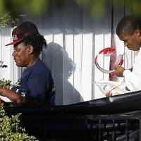 People leave the apartment unit in Dallas on Friday where Thomas Eric Duncan, a Liberian citizen diagnosed with the Ebola virus, stayed. | REUTERS