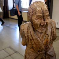A sculpture by Kazaemon Minagawa stands in the foyer of former Kadaki Town Hall as part of the artists-in-residence exhibition 'The Principle of Hope.' | MIO YAMADA