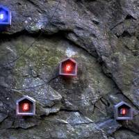 Tatsuo Miyajima's 'Hundred Life Houses,'  a collaborative project created with locals and students, is installed on the face of a rocky outcrop in Jobustu, Kunisaki, and overlooks a Jomon Period archeological site. | MIO YAMADA