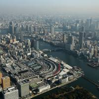 The sprawling Tsukiji fish market is shown at the center of this aerial photo of Tokyo on Dec. 2, 2013. MGM Resorts International is looking at the current location of the world's biggest fish market as a possible site for a casino resort that it wants to build. | BLOOMBERG