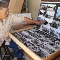 Kaneo Ogawa shows a collection of photos kept in a handmade wooden box at his home in Minami Ward, Nagoya. Ogawa, a local history researcher, spent months photographing the aftermath of Typhoon Vera, which killed more than 5,000 people in 1959 and remains the deadliest typhoon to strike Japan. | CHUNICHI SHIMBUN