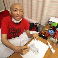 Cancer patient Yoshiki Ito sketches a soft drink can from his Nagoya hospital bed. He passed his high school entrance exam but can't progress further because the hospital doesn't offer a program at that level.   CHUNICHI SHIMBUN
