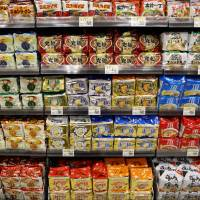 Instant noodles are displayed for sale at an Aeon Co. supermarket in Chiba on April 1. | BLOOMBERG