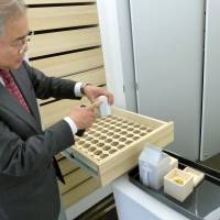 The GLA (God Light Association) burial vault offers followers the chance to store mementos of the deceased along with their remains. The facility is at the group's training center in Hokuto, Yamanashi Prefecture. | KYODO