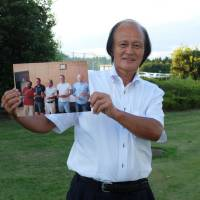 Nobuaki Kasahara holds a photo of himself taken in Pyongyang during an interview with The Japan Times in Ushiku, Ibaraki Prefecture, on Sept. 2. | MAGDALENA OSUMI