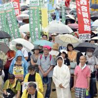 Up to 5,000 people stage a rally against the state secrets law in the city of Osaka in July. | KYODO