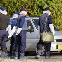 Police investigate an area near the scene of a double murder on Wednesday in Namporo, Hokkaido, after a 17-year-old girl was arrested for allegedly slashing her mother and grandmother with a knife. | KYODO