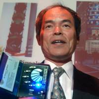 Professor Shuji Nakamura, named Tuesday as one of the winners of this year's Nobel Prize in physics, demonstrates different LED lights during a presentation in Santa Barbara, California, in June 2006, when he was awarded the $1.2 million Millennium Technology Prize for revolutionary inventions in light and laser technology. | AP