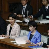 Industry minister Yuko Obuchi (second from left) attends a Lower House session Monday.  | REUTERS