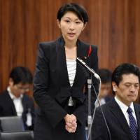 Industry minister Yuko Obuchi answers questions during an Upper House committee session on Thursday. | AFP-JIJI