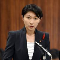 Trade minister Yuko Obuchi answers questions about the use of her political funds in the Diet on Thursday. | AFP-JIJI