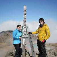 Yuki Tokoro (right) and Yuki Niwa pose at the summit of Mount Ontake on Sept. 27, in a photo recovered from Tokoro's camera. | KIYOKAZU TOKORO/KYODO