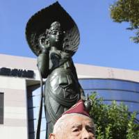 U.S. veteran William Sanchez, 96, of Monterey Park, California, visits the Heiwajima Kannon statue at the site of the Omori prison camp in Tokyo. He was among former POWs to visit Japan on a government friendship program that brings back survivors to speak about their experiences. | AP