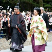 Princess Noriko, a daughter of the late Prince Takamado, Emperor Akihito's cousin, and Kunimaro Senge, 41, are wed at Izumo Taisha grand shrine in Shimane Prefecture where his family has been in charge of Shinto rituals for generations. | KYODO
