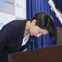 Trade and industry minister Yuko Obuchi announces her decision to resign over a political funds scandal at the Ministry of Economy, Trade and Industry on Monday morning. | KYODO