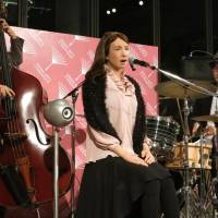 A humanoid robot belts out a jazz tune accompanied by a live band at the Marunouchi Building in Tokyo on Wednesday. | KAZUAKI NAGATA