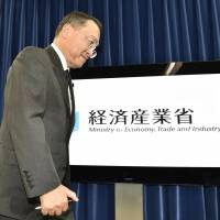 Trade minister Yoichi Miyazawa wraps up a news conference at the ministry on Tuesday, the day he succeeded Yuko Obuchi. She resigned a day earlier over allegations of murky funds accounting.   KYODO