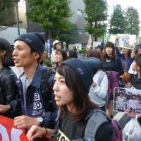 Students protesting against the state secrets law take part in a rally in Shibuya Ward, Tokyo, on Saturday.   SHUSUKE MURAI